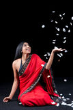 Beautiful Indian girl with rose petals Stock Images