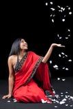 Beautiful Indian girl with rose petals Stock Image