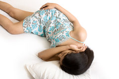 A beautiful Indian girl sleeping on bed Royalty Free Stock Image