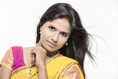 Beautiful Indian girl in traditional Indian half sari Royalty Free Stock Photography
