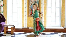 Beautiful Indian girls dancer indian dance. Two attractive girls in a sari dance a national dance stock video