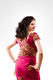 Beautiful Indian happy woman in pink sari Royalty Free Stock Photography