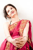 Beautiful Indian happy  woman in pink sari Royalty Free Stock Photo