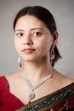 Beautiful Indian happy woman in red sari Royalty Free Stock Photo