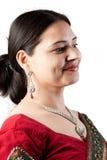 Beautiful Indian happy woman in red sari Stock Photo
