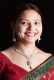 Beautiful Indian happy woman in red sari Stock Image
