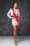 Beautiful indian lady in pink skirt and jacket with shiny diadem and pink ribbon. Pretty indian woman with stylish hairstyle. She has black hair and shiny crown Royalty Free Stock Photography