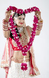 Beautiful Indian Muslim Bride on gray background with Garlands Royalty Free Stock Photography