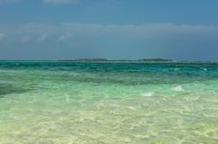 Beautiful Indian ocean with crystal clear water and blue sky, Maafushi Island, Maldives, Indian Ocean. Maldives - November, 2017: Beautiful Indian ocean with Stock Photography