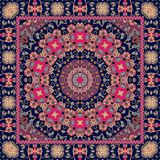 Beautiful indian rug with bright mandala. Ethnic pattern. Beautiful indian rug with bright mandala and unusual ornamental border. Tablecloth Stock Photo
