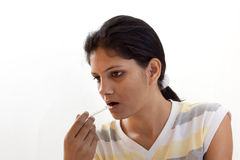 A beautiful Indian Sick girl with thermometer Stock Images