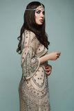 Beautiful indian style brunette young woman. With fashion dress in studio Stock Images