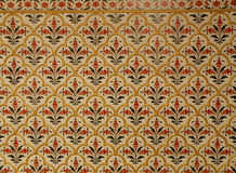 Beautiful Indian Style Pattern in Gold, Red, Dark Green on Off White Wall. In the Old Building of Rajasthan, India Royalty Free Stock Photos