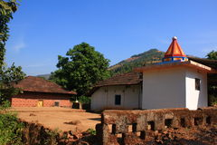 Beautiful Indian village architecture. A beautiful scene of an Indian village architecture with traditional houses along with a temple building Stock Image
