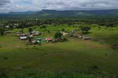 Beautiful Indian village Satara-I. A beautiful landscape of an Indian village with houses situated amidst green fields Royalty Free Stock Photos