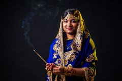 Free Beautiful Indian Woman Aromatic Stick Diwali Holiday On Black Background Studio Royalty Free Stock Images - 161496209