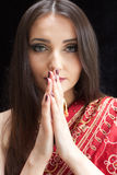 Beautiful Indian woman with blue eyes praying Royalty Free Stock Images