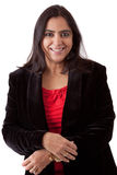 Beautiful Indian Woman in business attire. Portrait of an East Indian woman in a business attire against a white backdrop royalty free stock photos
