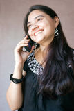 Beautiful Indian woman on cellphone Royalty Free Stock Photo