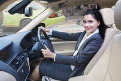 Beautiful indian woman driving car Royalty Free Stock Image