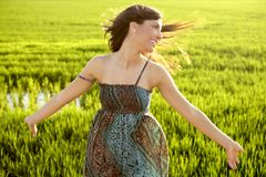 Beautiful indian woman in green rice fields Stock Photo