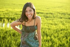 Beautiful  indian woman in green rice fields. Beautiful brunette indian young woman in the green rice fields meadow Royalty Free Stock Photos