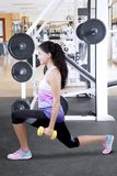 Beautiful Indian woman lifting weights royalty free stock photography