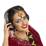 Beautiful Indian woman listening to music on headphones Royalty Free Stock Photo