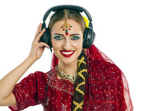 Beautiful Indian woman listening to music on headphones Stock Images