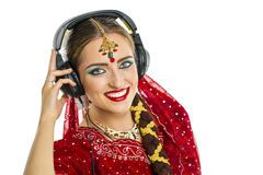 Beautiful Indian woman listening to music on headphones Royalty Free Stock Photography
