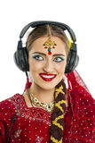 Beautiful Indian woman listening to music on headphones Stock Photo