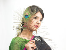 Beautiful indian woman with peacock feather Stock Photo