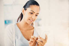Beautiful Indian woman sending text message mobile phone happy Stock Image
