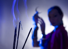 Beautiful indian woman silhouette with incense holding a moon Royalty Free Stock Photography