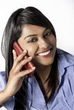 Beautiful Indian Woman talking on her cellphone Stock Image