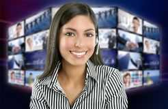 Beautiful indian woman television news presenter. With multiple screen background Stock Image