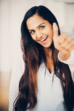 Beautiful Indian woman thumbs up happy smiling Royalty Free Stock Images