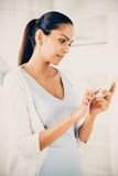 Beautiful Indian woman using mobile phone happy Stock Photos