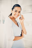 Beautiful Indian woman using mobile phone happy Royalty Free Stock Photos