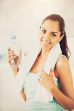 Beautiful Indian woman water bottle fitness healthy happy Royalty Free Stock Images