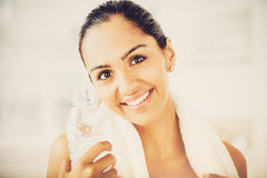 Beautiful Indian woman water bottle fitness healthy happy Royalty Free Stock Photography
