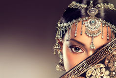 Beautiful Indian women portrait with jewelry. Royalty Free Stock Images