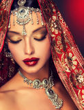 Beautiful Indian women portrait with jewelry. Beautiful Indian woman portrait with jewelry. elegant Indian girl looking to the side ,bollywood style Stock Photography
