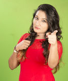 Beautiful indian women posse studio green background Royalty Free Stock Photography