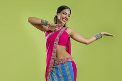 Beautiful indian young brunette woman dancing Royalty Free Stock Photos