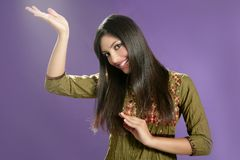 Beautiful indian young brunette woman posing hands Royalty Free Stock Image