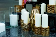 Beautiful Indonesian carved candle holders with candles.Warm and beautiful Royalty Free Stock Photography