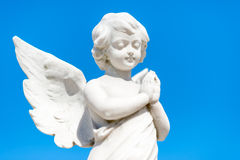 Beautiful infant angel on a blue sky Stock Images