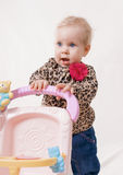 Beautiful infant with baby carriage Stock Photo