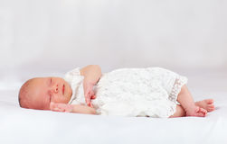 Beautiful infant baby girl sleeping, three weeks old Stock Image